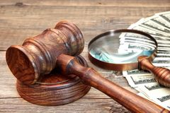 Gavel, USA Dollars and Vintage Magnifying Glass Stock Image