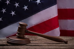 Gavel on USA flag background. Brown gavel on wooden surface. Verdict will be harsh. Court works to protect rights royalty free stock photos