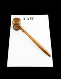 Gavel on white paper isolated Stock Image