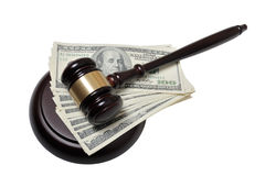 Gavel whith dollars on a white background Stock Image