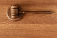 Gavel on a wood surface. Gavel with support on a wood surface Royalty Free Stock Photography
