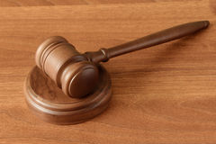 Gavel on a wood surface Royalty Free Stock Images