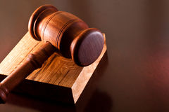 Gavel. And wooden cube on your desktop Stock Images