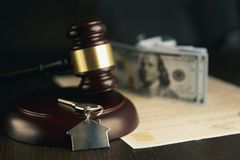 Gavel wooden and house for home buying or selling of bidding or lawyer of home real estate and auction concept.
