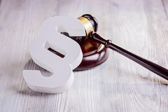 Gavel and wooden paragraph - law symbols Stock Images