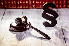 Gavel and wooden paragraph the symbols of law Stock Image