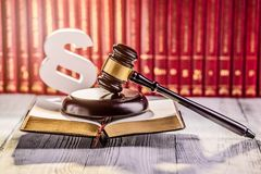 Gavel and wooden paragraph. The symbols of law in court library with legal codes. Law concept Stock Photos