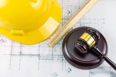 Gavel and yellow safety helmet royalty free stock photography