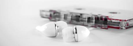Gaveta com rolos e fones de ouvido Fotos de Stock Royalty Free