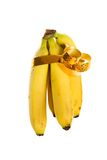 Gavilla de plátanos en el embalaje del regalo Fotografía de archivo libre de regalías