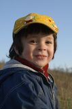 The gay boy. The little boy in the yellow cap Royalty Free Stock Image