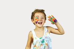 Gay boy covered in paint . Cheerful artist. A boy smeared with colours on a grey background stock photography