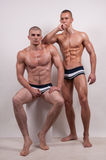 Gay couple. Two muscled gay men in a studio Royalty Free Stock Photo