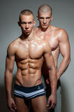 Gay couple. Two muscled gay men in a studio