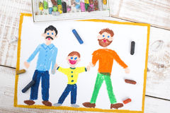 Gay couple and adopted child Royalty Free Stock Photo