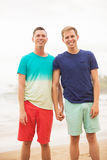 Gay couple on the beach Royalty Free Stock Photos