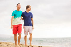 Gay couple on the beach. Happy gay couple walking on the beach Stock Photo