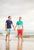 Gay couple on the beach Royalty Free Stock Photos
