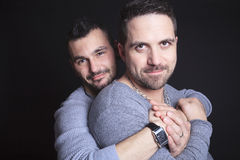Gay couple on black background Stock Image
