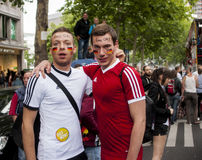 Gay couple dressed as football players. BERLIN, GERMANY - JUNE 21, 2014:Christopher Street Day.Elaborately dressed people participate in the parade celebrates Royalty Free Stock Image