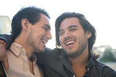 Gay couple embraced closely royalty free stock images