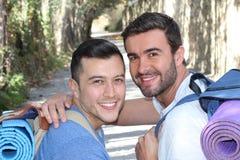 Gay couple enjoying a hike royalty free stock images