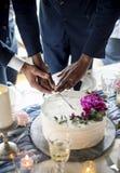 Gay Couple Hands Cutting Wedding Cake. Gay couple hands cutting a wedding cake Royalty Free Stock Photo