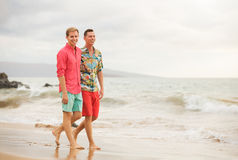 Gay couple. Happy gay couple walking on the beach Royalty Free Stock Photography