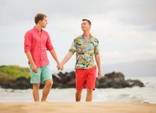 Gay couple. Happy gay couple walking on the beach Stock Photo