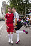 Gay couple in heels, dressed as football players. Stock Photo