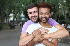 Gay couple holding each other outdoors royalty free stock image