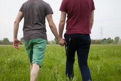 Gay couple holding hands Stock Images