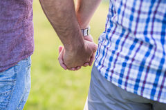 Gay couple holding hands outdoor Stock Photos