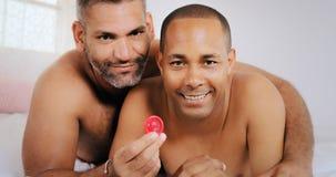 Gay Couple Homosexual Couple Men Showing Condom For Safe Sex Royalty Free Stock Photos