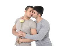 Gay couple of homosexual young strong men in love on valentines with rose Stock Photography