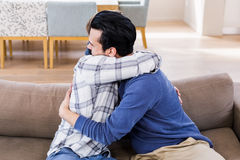 Gay couple hugging each other Stock Photo