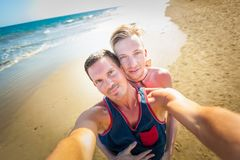 Gay couple in love at the beach Royalty Free Stock Photos