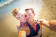 Gay couple in love at the beach Stock Photography