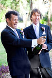 Gay Couple Opening Champagne Royalty Free Stock Photo