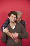 Gay couple on red background stock photography