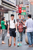 Gay couple in shopping area, Shanghai, China Stock Photos
