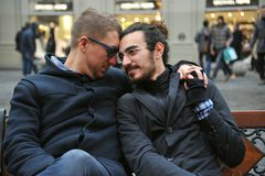 Gay couple on the streets of Florence city , Italy