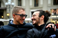 Gay couple smiling on the streets of Florence , Italy