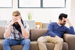 Gay couple sulking each other Stock Image