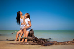 Gay couple on vacation. Lesbian couple on vacation at the beach Royalty Free Stock Image