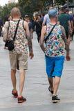 Gay Couple walking around Madrid Stock Photos