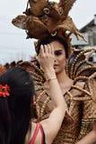 Gay cultural street dancer fixing make up. San Pablo City, Laguna, Philippines - January 13, 2018: Gay cultural street dancer fixing make up in the midst of Royalty Free Stock Photography