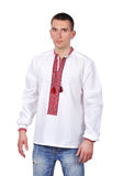 Gay in embroidered shirt Stock Images