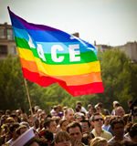 Gay flag. Above the people marching during the parade of the annual Gay Pride aka Marche des Fiertes LGBT on June 26, 2010 in Paris. Tens of thousands of French stock images