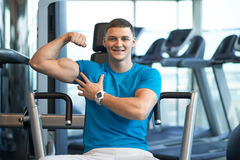 Gay guy shows bulging muscles Stock Photography